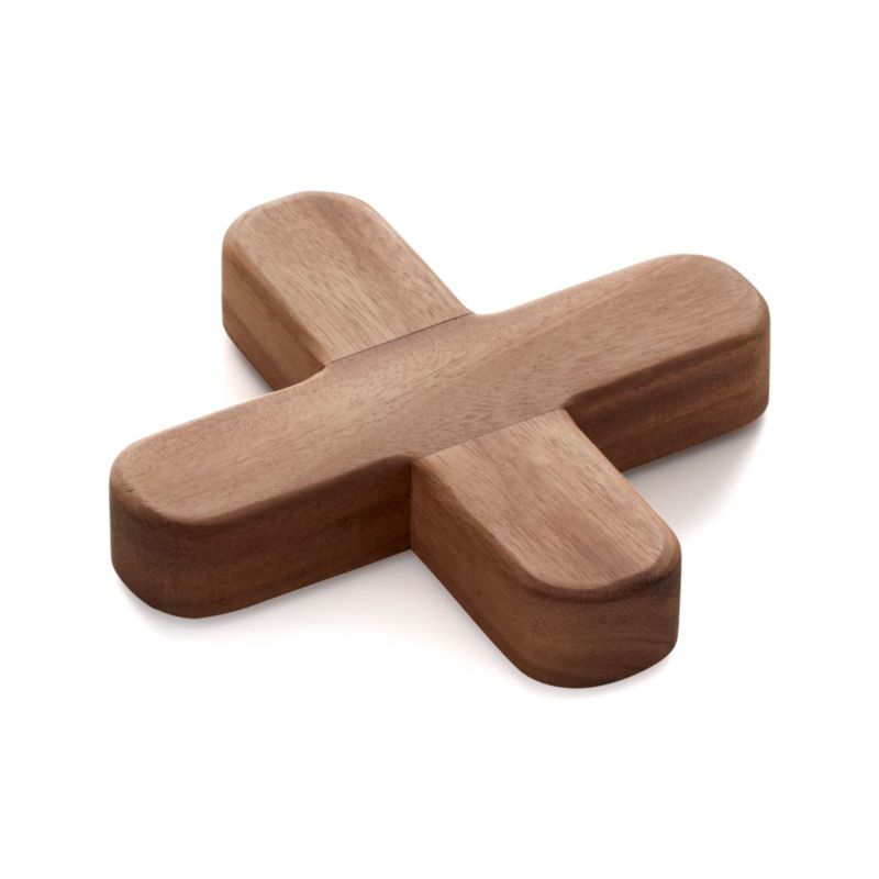 X marks the spot for hot pots and dishes with our richly grained acacia trivet, a warm wood table accent with a dimensional shape and a practical purpose. Works best with square dishes.<br /><br /><NEWTAG/><ul><li>Acacia wood</li><li>Hand wash (do not soak)</li><li>Made in Thailand</li></ul>