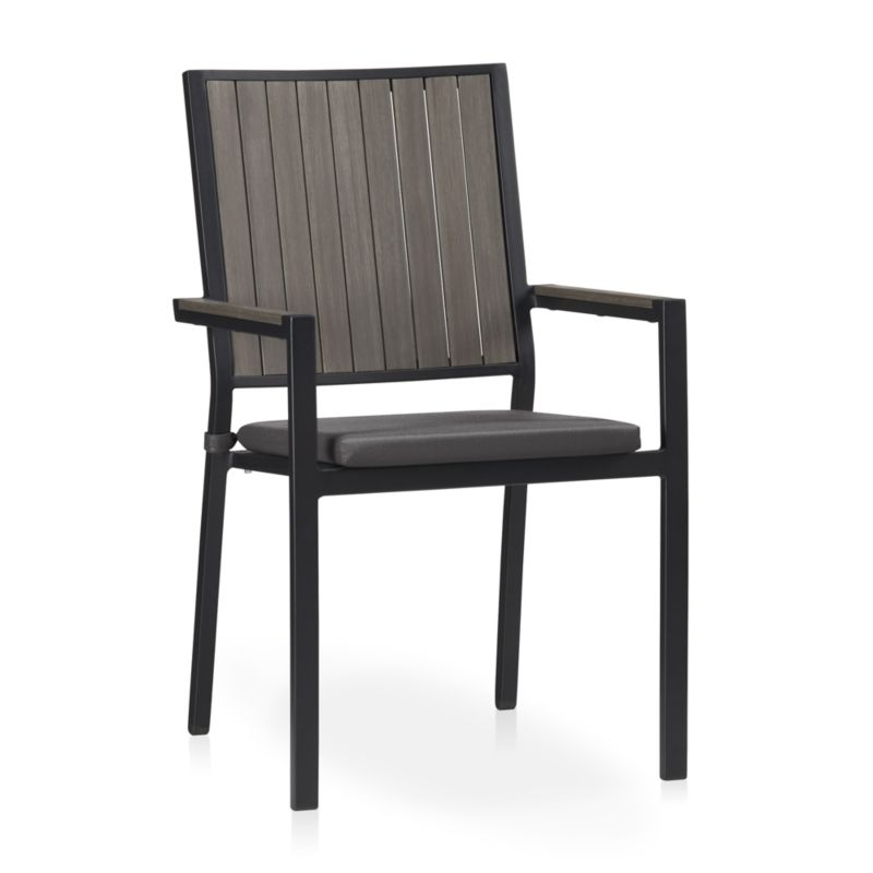 Casual and stylish, our stackable Alfresco outdoor dining chair fools the eye with the look of real wood and fools the elements with UV- and fade-resistant qualities for outdoor living. Slats of innovative warm grey polystyrene faux wood are treated with UV and anti-oxidant protection. <NEWTAG/><ul><li>Extruded polystyrene with UV and anti-oxidant protection</li><li>Aluminum frame with powdercoat finish</li><li>Fade- and mildew-resistant Sunbrella acrylic cushion</li><li>Foam cushion fill</li><li>Fabric tab fasteners</li><li>Stacks up to 4 high for easy storage</li><li>Material origin: see swatch</li><li>Made in China and USA </li></ul><br />