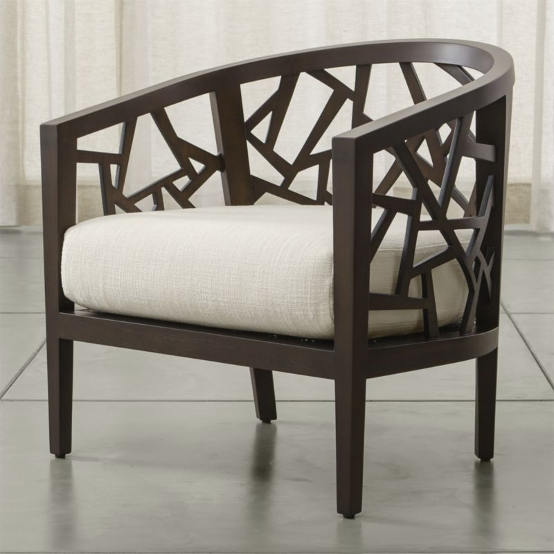 Designed to be appreciated from every angle, Ankara's intricate open curve of hand-cut and hand-pieced hardwood opens up an artistic and architectural 360-degree view in the living room. <NEWTAG/><ul><li>Frame is benchmade with precision-cut solid mahogany, hardwood plywood, and a cane seat</li><li>Synthetic webbing suspension system</li><li>Soy-based polyfoam cushion with fiber encased in downproof ticking</li><li>Frame stained with truffle brown finish and clear protective lacquer</li><li>Material origin: see swatch</li><li>Made in Indonesia and USA </li></ul>
