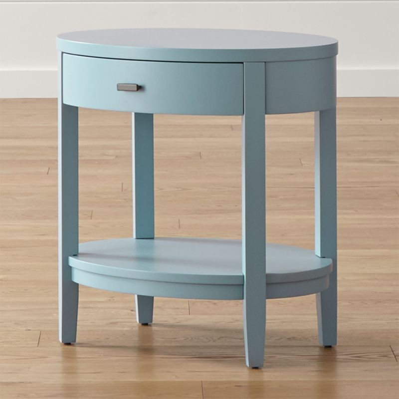 With streamlined cottage appeal, the Arch nightstand sits beside the bed with a fresh, blue finish and charming oval shape. Designed by Blake Tovin, the Arch oval nightstand offers one<br />bow-front storage drawer, curved in contrast to the nightstand's squared legs. <NEWTAG/><ul><li>Designed by Blake Tovin of Tovin Design</li><li>Solid poplar, engineered wood and plywood with blue lacquer finish over white sealer</li><li>Naturally expands and contracts with changes in humidity</li><li>1 drawer with metal side-mounted glides and antique brass pull</li><li>1 fixed shelf</li><li>Levelers</li><li>Made in Vietnam</li></ul>