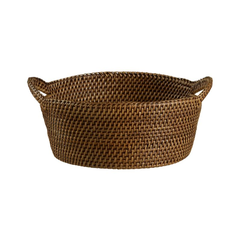 A honey brown finish warms this handcrafted rattan basket. Each is made with a fine, tight weave and ear handles for sturdy serving.<br /><br /><NEWTAG/><ul><li>Handwoven rattan</li><li>Honey brown finish</li><li>Foodsafe lacquer finish</li><li>Liner recommended to extend wear</li><li>Clean with a dry cloth</li><li>Made in The Philippines</li></ul>