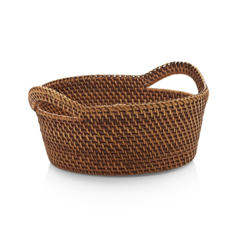 Handcrafted of 100% rattan, the Artesia serving collection is woven in a pattern known as hapao. Originating in a remote village in northern Luzon, the largest island in the Philippines, hapao is a traditional pattern used for bags and baskets. Over time, the colors used and shapes formed changed, though always emphasizing the durability and natural beauty of this amazing fiber. Each piece in the Artesia collection is finished in beautiful honey brown, calling out the texture and intricacy of the weave and bringing warm color to the table. Ear handles with braid detailing on the rim accent this generous-sized basket, perfect for serving crackers and bread.<br /><br /><NEWTAG/><ul><li>Handcrafted</li><li>100% rattan</li><li>Non-toxic, food-safe coating</li><li>Clean with dry or damp cloth</li><li>Made in The Philippines</li></ul>