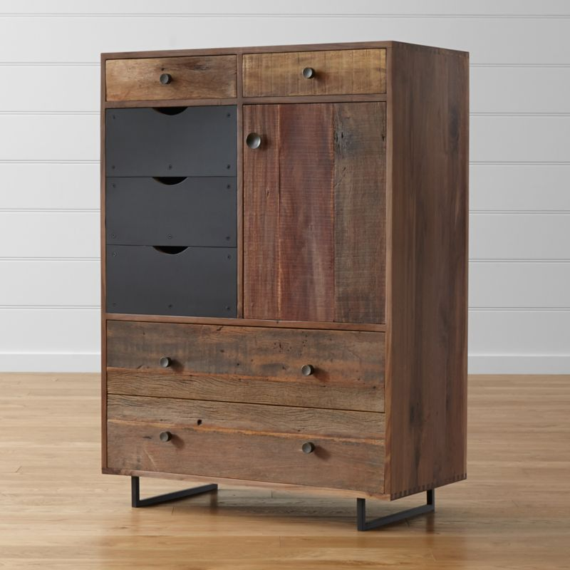With the eclectic allure of a flea market find, our Atwood tall chest combines 4 traditional drawers, an open cubicle and 3 easy-access bins in a versatile storage option with loads of character. Rustic reclaimed Brazilian peroba wood with unique aspects in every plank is framed in refined solid American black walnut and stands in stark, contemporary contrast to the black steel-faced bin drawers. <NEWTAG/><ul><li>Reclaimed peroba wood and solid black walnut</li><li>Welded steel legs with lacquer topcoat</li><li>As with all solid woods, expansion and contraction may occur with seasonal changes in humidity</li><li>Natural beeswax finish on peroba; lacquer finish on walnut</li><li>4 wood drawers have undermount metal drawer glides</li><li>3 drawers with black steel faces have cutout pulls</li><li>Dovetail joinery</li><li>Iron knobs with antique finish</li><li>Made in Mexico</li></ul>