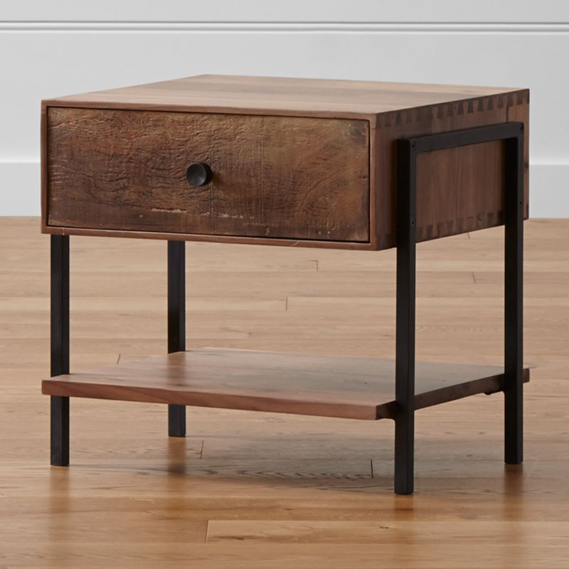 Our Atwood nightstand's eclectic nature mixes rustic reclaimed peroba wood from Brazil with refined solid American black walnut. This nightstand's uniquely weathered peroba wood drawer and a bottom shelf offer generous storage, supported by a walnut frame with dovetail joinery and steel sled legs. The Atwood Nightstand is a Crate and Barrel exclusive.<br /><br /><NEWTAG/><ul><li> Reclaimed peroba wood  front with natural beeswax finish</li><li>Solid black walnut frame with lacquer finish</li><li>Welded steel legs with lacquer topcoat</li><li>As with all solid woods, expansion and contraction may occur with seasonal changes in humidity</li><li>Dovetail joinery</li><li>1 drawer with undermount metal drawer glide</li><li>Iron knob with antique finish</li><li>Made in Mexico</li></ul>