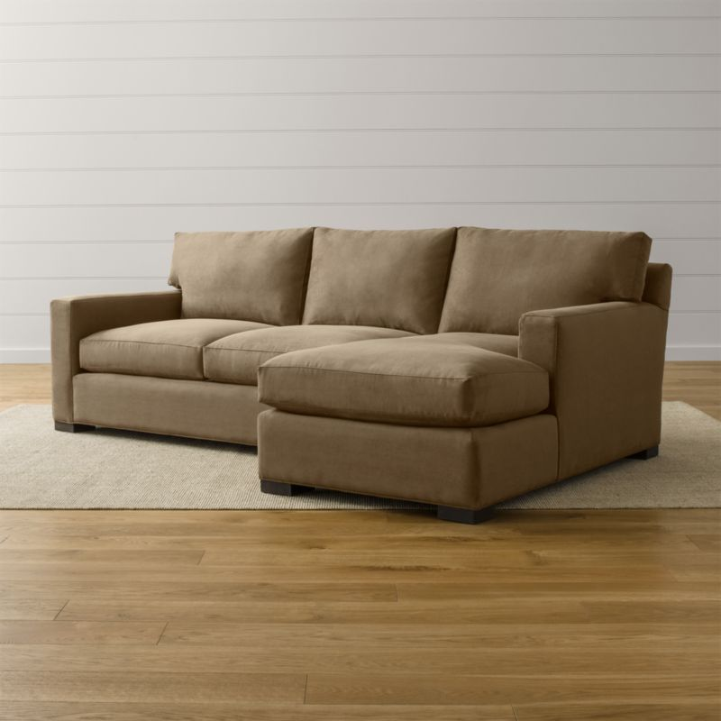 Bring Axis home and watch life revolve around it. Upholstered in a high-performance fabric that's pet, kid, and family friendly, this collection offers exceptional durability for family rooms and casual living rooms—and the versatility to customize your ideal sectional. This 2-piece sectional is comprised of the right arm chaise and left arm apartment sofa. <NEWTAG/><ul><li>Frames are benchmade in the USA with certified sustainable hardwood that's kiln-dried to prevent warping</li><li>Flexolator spring suspension systems</li><li>Soy-based polyfoam seat cushions wrapped in fiber-down blend and encased in downproof ticking</li><li>Fiber-down back cushions encased in downproof ticking</li><li>Hardwood legs stained with a hickory brown finish</li><li>Material origin: see swatch</li><li>Made in North Carolina, USA</li></ul>