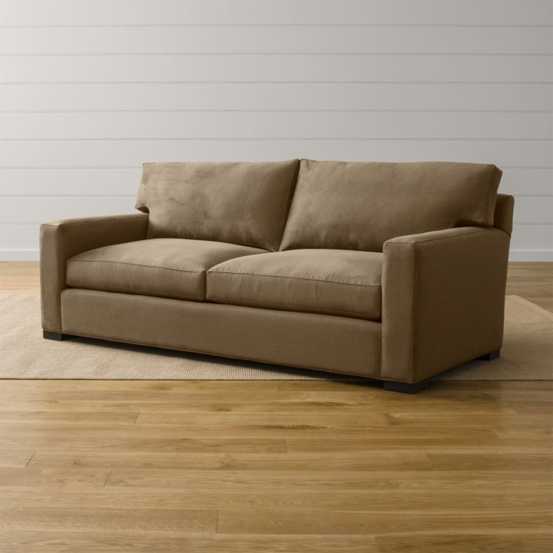 Bring Axis home and watch life revolve around it. Upholstered in a high-performance fabric that's pet, kid, and family friendly, this 2-seat sofa offers exceptional durability for family rooms and casual living rooms. <NEWTAG/><ul><li>Frame is benchmade in the USA with certified sustainable hardwood that's kiln-dried to prevent warping</li><li>Flexolator spring suspension system</li><li>Soy-based polyfoam seat cushions wrapped in fiber-down blend and encased in downproof ticking</li><li>Fiber-down back cushions encased in downproof ticking</li><li>Hardwood legs stained with a hickory brown finish</li><li>Material origin: see swatch</li><li>Made in North Carolina, USA</li></ul>