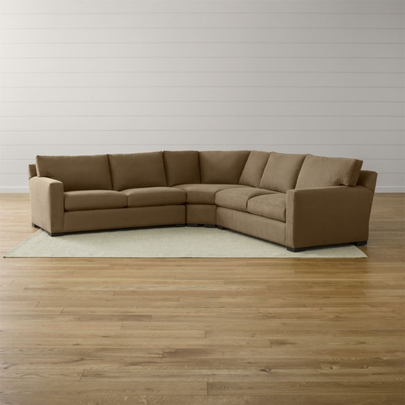 Bring Axis home and watch life revolve around it. Upholstered in a high-performance fabric that's pet, kid, and family friendly, this collection offers exceptional durability for family rooms and casual living rooms—and the versatility to customize your ideal sectional. This 3-piece sectional is comprised of the left arm apartment sofa, right arm apartment sofa and wedge.  <NEWTAG/><ul><li>Frames are benchmade in the USA with certified sustainable hardwood that's kiln-dried to prevent warping</li><li>Flexolator spring suspension systems</li><li>Soy-based polyfoam seat cushions wrapped in fiber-down blend and encased in downproof ticking</li><li>Fiber-down back cushions encased in downproof ticking</li><li>Hardwood legs stained with a hickory brown finish</li><li>Material origin: see swatch</li><li>Made in North Carolina, USA</li></ul>
