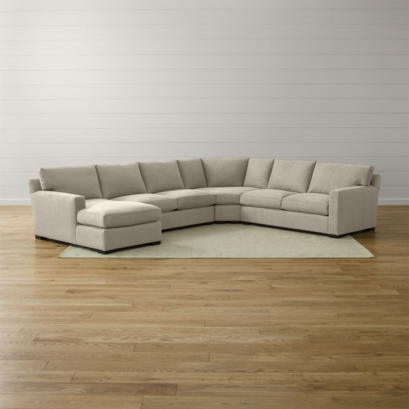 Bring Axis home and watch life revolve around it. Upholstered in a high-performance fabric that's pet, kid, and family friendly, this collection offers exceptional durability for family rooms and casual living rooms—and the versatility to customize your ideal sectional. This 4-piece sectional is comprised of the left arm chaise, armless loveseat, right arm apartment sofa and wedge. <NEWTAG/><ul><li>Frames are benchmade in the USA with certified sustainable hardwood that's kiln-dried to prevent warping</li><li>Flexolator spring suspension systems</li><li>Soy-based polyfoam seat cushions wrapped in fiber-down blend and encased in downproof ticking</li><li>Fiber-down back cushions encased in downproof ticking</li><li>Hardwood legs stained with a hickory brown finish</li><li>Material origin: see swatch</li><li>Made in North Carolina, USA</li></ul>