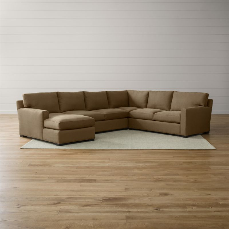 Bring Axis home and watch life revolve around it. Upholstered in a high-performance fabric that's pet, kid, and family friendly, this collection offers exceptional durability for family rooms and casual living rooms—and the versatility to customize your ideal sectional. This 4-piece sectional is comprised of the right arm apartment sofa, loveseat, left arm chaise and corner. <NEWTAG/><ul><li>Frames are benchmade in the USA with certified sustainable hardwood that's kiln-dried to prevent warping</li><li>Flexolator spring suspension systems</li><li>Soy-based polyfoam seat cushions wrapped in fiber-down blend and encased in downproof ticking</li><li>Fiber-down back cushions encased in downproof ticking</li><li>Hardwood legs stained with a hickory brown finish</li><li>Material origin: see swatch</li><li>Made in North Carolina, USA</li></ul>