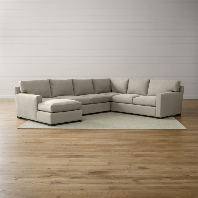 Bring Axis home and watch life revolve around it. Upholstered in a high-performance fabric that's pet, kid, and family friendly, this collection offers exceptional durability for family rooms and casual living rooms—and the versatility to customize your ideal sectional. This 4-piece sectional is comprised of the right arm apartment sofa, loveseat, left arm chaise and corner. <NEWTAG/><ul><li>Frames are benchmade in the USA with certified sustainable hardwood that's kiln-dried to prevent warping</li><li>Flexolator spring suspension systems</li><li>Soy-based polyfoam seat cushions wrapped in fiber-down blend and encased in downproof ticking</li><li>Fiber-down back cushions encased in downproof ticking</li><li>Hardwood legs stained with a hickory brown