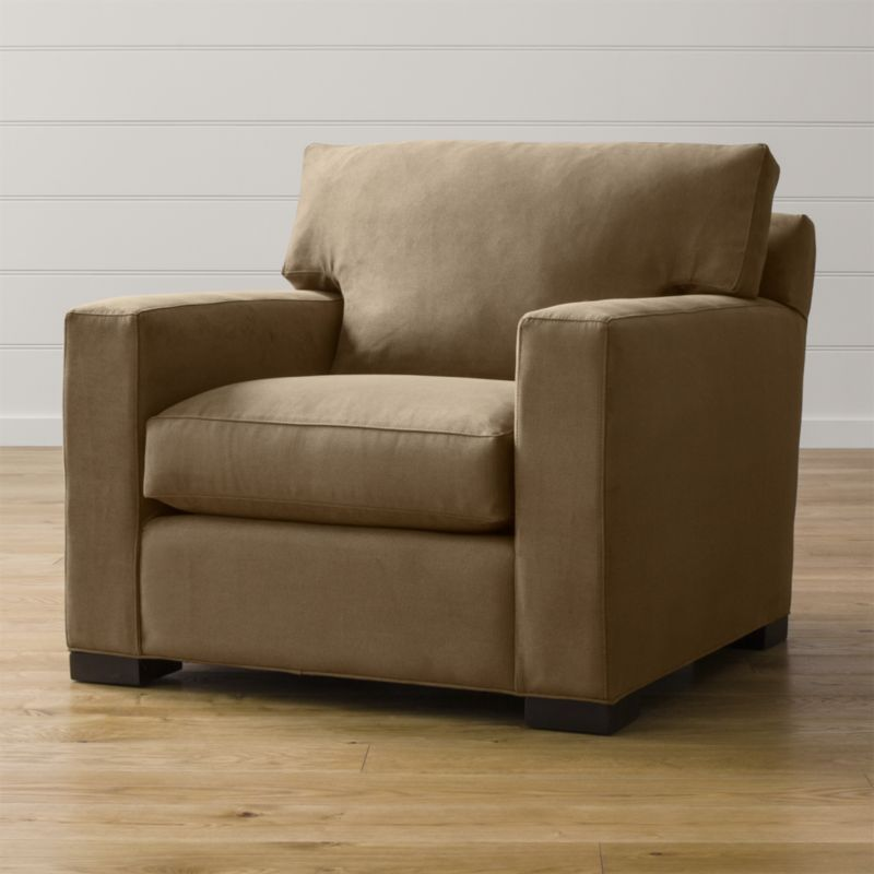 Bring Axis home and watch life revolve around it. Upholstered in a high-performance fabric that's pet, kid, and family friendly, this oversized chair offers exceptional durability for family rooms and casual living rooms. <NEWTAG/><ul><li>Frame is benchmade in the USA with certified sustainable hardwood that's kiln-dried to prevent warping</li><li>Flexolator spring suspension system</li><li>Soy-based polyfoam seat cushion wrapped in fiber-down blend and encased in downproof ticking</li><li>Fiber-down back cushion encased in downproof ticking</li><li>Hardwood legs stained with a hickory brown finish</li><li>Material origin: see swatch</li><li>Made in North Carolina, USA</li></ul>