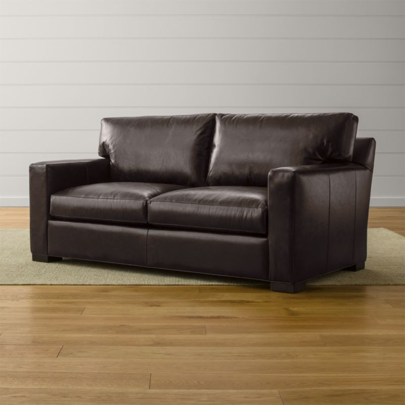 Bring Axis home and watch life revolve around it. Upholstered in top-grain, full-aniline dyed leather that gains character over time, this apartment sofa offers laid-back comfort in family rooms and casual living rooms. <NEWTAG/><ul><li>Frame is benchmade in the USA with certified sustainable hardwood that's kiln-dried to prevent warping</li><li>Flexolator spring suspension system</li><li>Soy-based polyfoam seat cushions wrapped in fiber-down blend and encased in downproof ticking</li><li>Fiber-down back cushions encased in downproof ticking</li><li>Hardwood legs stained with a hickory brown finish</li><li>Material origin: see swatch</li><li>Made in North Carolina, USA</li></ul>