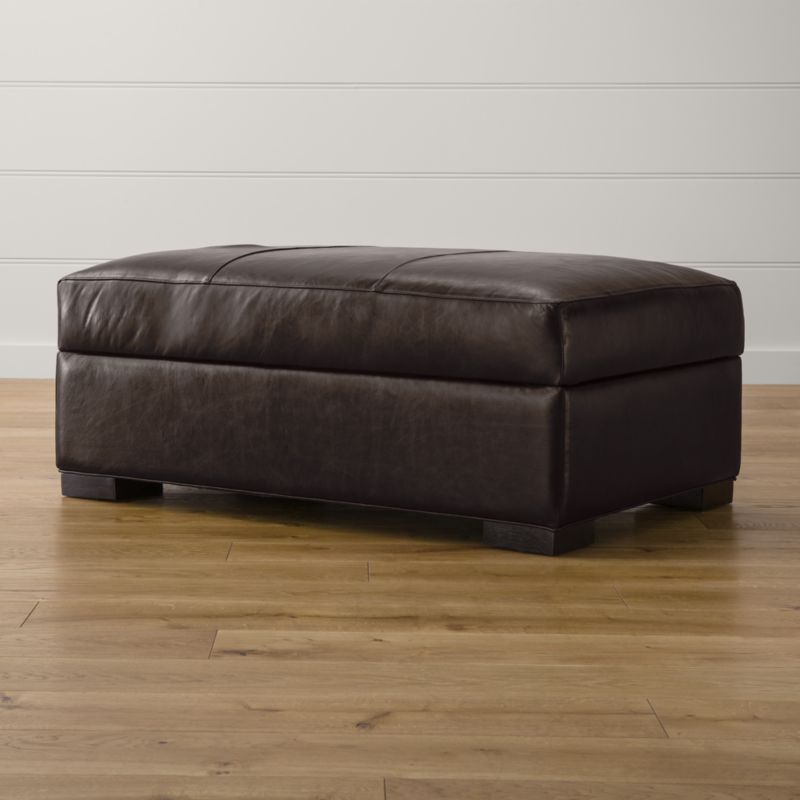 Bring Axis home and watch life revolve around it. Upholstered in top-grain, full-aniline dyed leather that gains character over time, this storage ottoman offers laid-back comfort in family rooms and casual living rooms. Not surprisingly, Axis has been a customer favorite for more than a decade. Axis II Leather Storage Ottoman is a Crate and Barrel exclusive.<br /><br /><NEWTAG/><ul><li>Frame is benchmade in the USA with certified sustainable hardwood that's kiln-dried to prevent warping</li><li>Flexolator spring suspension system</li><li>Soy-based polyfoam seat cushion wrapped in fiber-down blend and encased in downproof ticking</li><li>Spring-assisted hinged lid locks open for easy access</li><li>Hardwood legs stained with a hickory brown finish</li><li>Material origin: see swatch</li><li>Made in North Carolina, USA</li></ul><br />