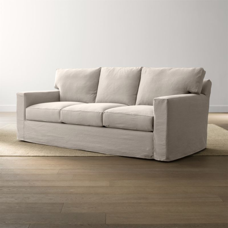 Bring Axis home and watch life revolve around it. Ideal for family rooms and casual living rooms, this 3-seat sofa features a removable denim slipcover that's machine-washable and as soft as a lived-in pair of jeans. <NEWTAG/><ul><li>Frame is benchmade in the USA with certified sustainable hardwood that's kiln-dried to prevent warping</li><li>Flexolator spring suspension system</li><li>Soy-based polyfoam seat cushions wrapped in fiber-down blend and encased in downproof ticking</li><li>Fiber-down back cushions encased in downproof ticking</li><li>Removable slipcovers are machine washable</li><li>Hardwood legs stained with a hickory brown finish</li><li>Material origin: see swatch</li><li>Made in North Carolina, USA</li></ul><br />