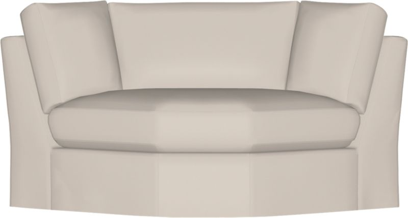 Snug-fitting slipcovers hug the plush contours of one of our most popular seating solutions, tailored with sleek floor-length skirts and crisp topstitching.<br /><br />After you place your order, we will send a fabric swatch via next day air for your final approval. We will contact you to verify both your receipt and approval of the fabric swatch before finalizing your order.<br /><br /><NEWTAG/><ul><li>Machine washable</li><li>Tailor-made</li><li>Topstitching</li><li>Made in North Carolina, USA</li></ul>
