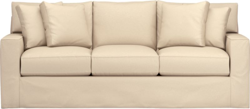 "Snug-fitting slipcovers hug Axis's deep and roomy contours, tailor-made with sleek floor-length skirt and crisp topstitching.<br /><br />Additional <a href=""http://crateandbarrel.custhelp.com/cgi-bin/crateandbarrel.cfg/php/enduser/crate_answer.php?popup=-1&p_faqid=125&p_sid=DMUxFvPi"">slipcovers</a> available through stores featuring our Furniture Collection.<br /><br />After you place your order, we will send a fabric swatch via next day air for your final approval. We will contact you to verify both your receipt and approval of the fabric swatch before finalizing your order.<br /><br /><NEWTAG/><ul><li>Machine washable</li><li>Topstitching detail</li><li>See additional frame o"