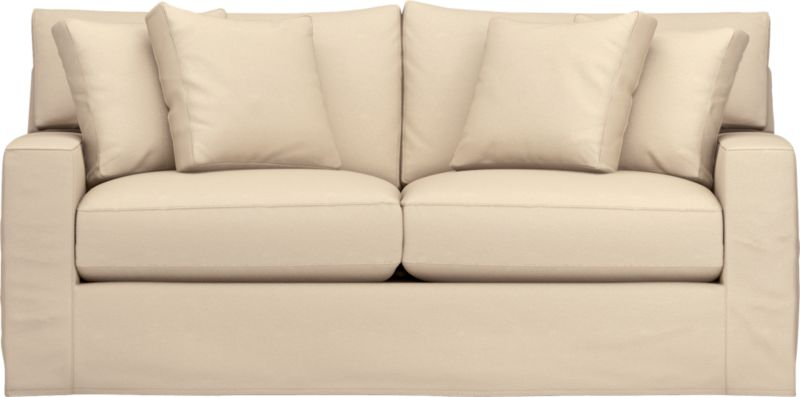 "Snug-fitting slipcovers hug Axis's deep and roomy contours, tailor-made with sleek floor-length skirt and crisp topstitching.<br /><br />Additional <a href=""http://crateandbarrel.custhelp.com/cgi-bin/crateandbarrel.cfg/php/enduser/crate_answer.php?popup=-1&p_faqid=125&p_sid=DMUxFvPi"">slipcovers</a> available through stores featuring our Furniture Collection.<br /><br />After you place your order, we will send a fabric swatch via next day air for your final approval. We will contact you to verify both your receipt and approval of the fabric swatch before finalizing your order.<br /><br /><NEWTAG/><ul><li>Machine washable</li><li>Topstitching detail</li><li>See additional frame"
