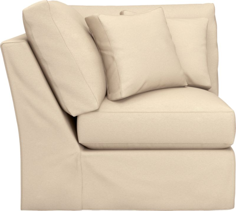 "Snug-fitting slipcovers hug Axis's deep and roomy contours, tailor-made with sleek floor-length skirt and crisp topstitching.<br /><br />Additional <a href=""http://crateandbarrel.custhelp.com/cgi-bin/crateandbarrel.cfg/php/enduser/crate_answer.php?popup=-1&p_faqid=125&p_sid=DMUxFvPi"">slipcovers</a> available through stores featuring our Furniture Collection.<br /><br />After you place your order, we will send a fabric swatch via next day air for your final approval. We will contact you to verify both your receipt and approval of the fabric swatch before finalizing your order.<br /><br /><NEWTAG/><ul><li>Machine washable</li><li>Topstitching detail</li><li>See addition"