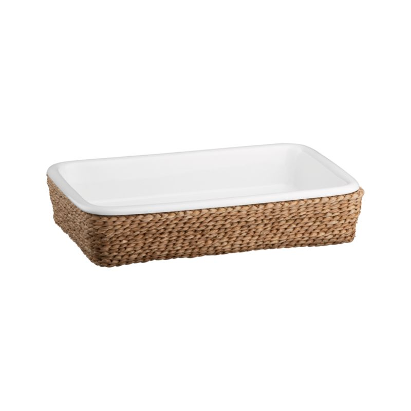 A beautiful serving solution nests an oven-to-table white porcelain rectangle in a rustic handwoven fiber basket. Decorative and functional, the basket serves as a trivet to protect tables and countertops, or can be used separately for breads and rolls. Perfect for passing hot dishes at the table.<br /><br /><NEWTAG/><ul><li>High fired porcelain baker</li><li>All natural bankuang fiber basket</li><li>Basket is food safe</li><li>Dishwasher-, freezer-, microwave- and oven-safe</li><li>Clean basket with a dry cloth only</li><li>Made in The Philippines and China </li></ul>