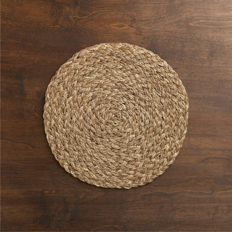 Textural round of hand-braided abaca delivers an earthy yet sophisticated presence to your table.  The durable fiber grows in abundance in the Philippines and is biodegradable.<br /><br /><NEWTAG/><ul><li>Placemat is 100% biodegradable, eco-friendly abaca</li><li>Clean placemat with a soft bristle brush to remove crumbs</li><li>Made in The Philippines</li></ul><br /><br />