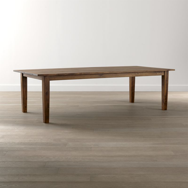 "Recalling the heft and character of a European farmhouse antique, this grandly scaled, 104"" dining table is handcrafted with hand-planed planks of sustainable solid mango wood and finished with authentic peg detailing. Simple and rustic, the 104"" dining table's bold proportions are enhanced with a rich honey stain and lacquer finish. <NEWTAG/><ul><li>Sustainable solid mango wood</li><li>Rich honey stain with lacquer and wax finish</li><li>Hand-planed wooden planks</li><li>Peg detailing</li><li>Naturally occurring grain and knots</li><li>Seats 10</li><li>Made in India</li></ul><br />"