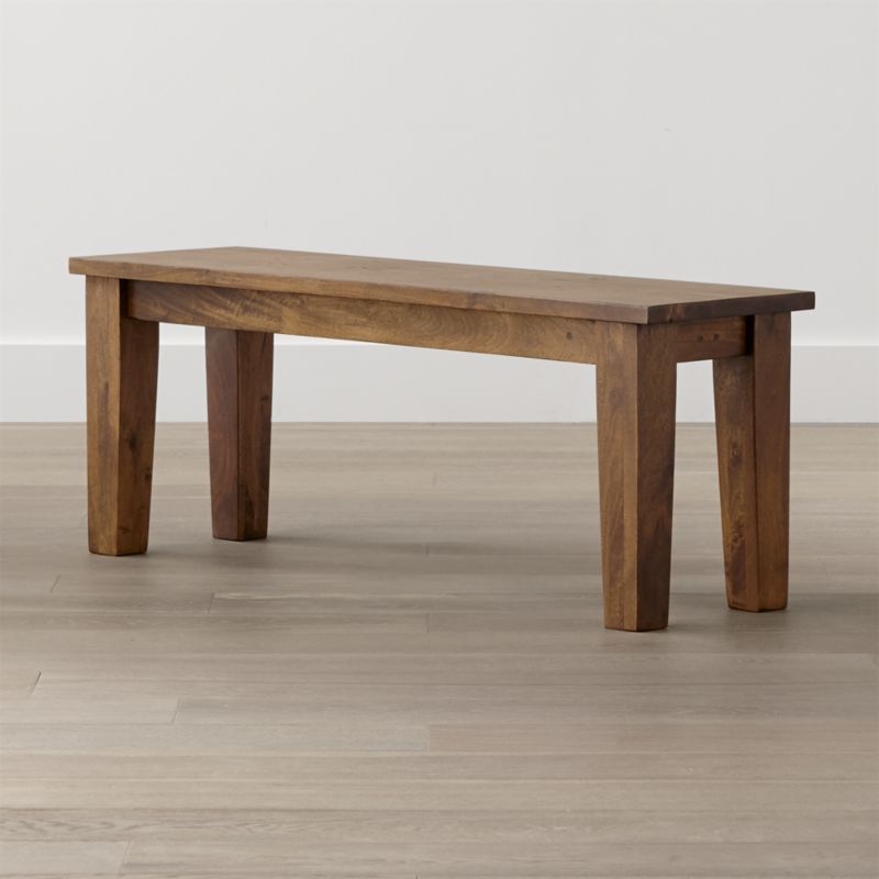 """Simply rustic with the heft and character of a European farmhouse antique, the Basque 48"""" bench is a casual option for seating 2 at the Basque 65"""" dining table. Each compact bench is handcrafted entirely using hand-planed wooden planks of sustainable solid mango wood with authentic peg detailing. <NEWTAG/><ul><li>Sustainable solid mango wood</li><li>Rich honey stain with lacquer and wax finish</li><li>Hand-planed wooden planks</li><li>Peg detailing</li><li>Naturally occurring grain and knots</li><li>Seats 2</li><li>Made in India</li></ul><br />"""