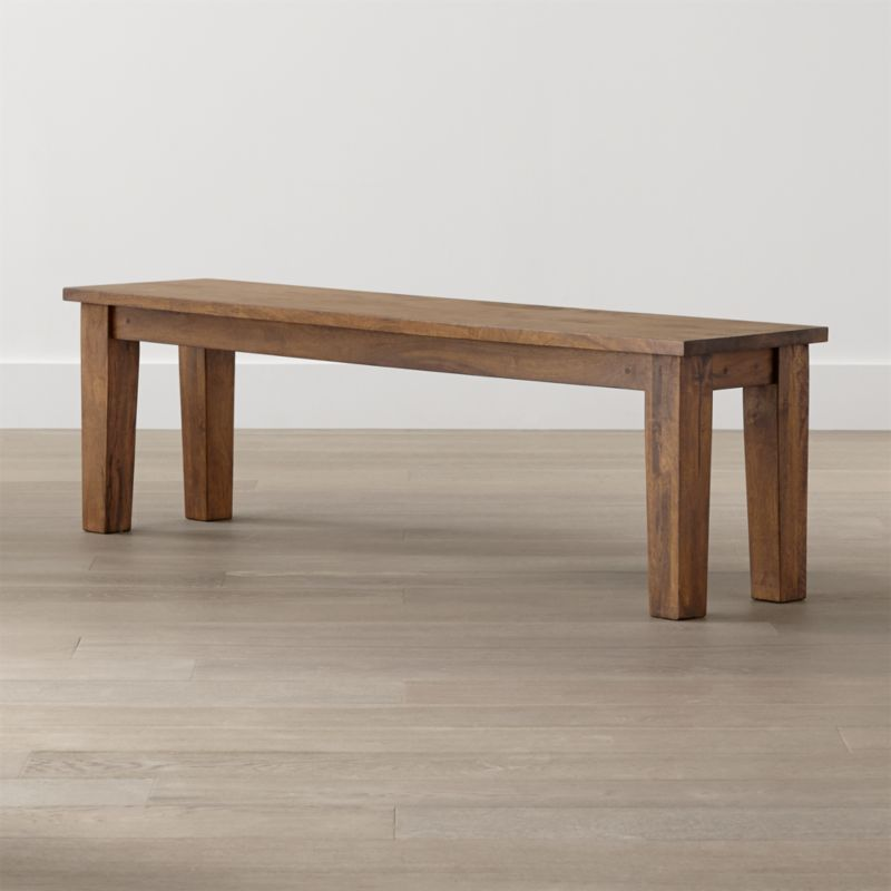 Displaying the heft and character of a European farmhouse antique, this mid-sized bench echoes the simple and rustic character of our Basque dining collection. Hand-planed planks of sustainable solid mango wood are enhanced with peg detailing lend unmistakable authenticity to the expert craftsmanship. <NEWTAG/><ul><li>Sustainable solid mango wood</li><li>Rich honey stain with lacquer and wax finish</li><li>Hand-planed wooden planks</li><li>Peg detailing</li><li>Naturally occurring grain and knots</li><li>Seats 3</li><li>Made in India</li></ul><br />&l