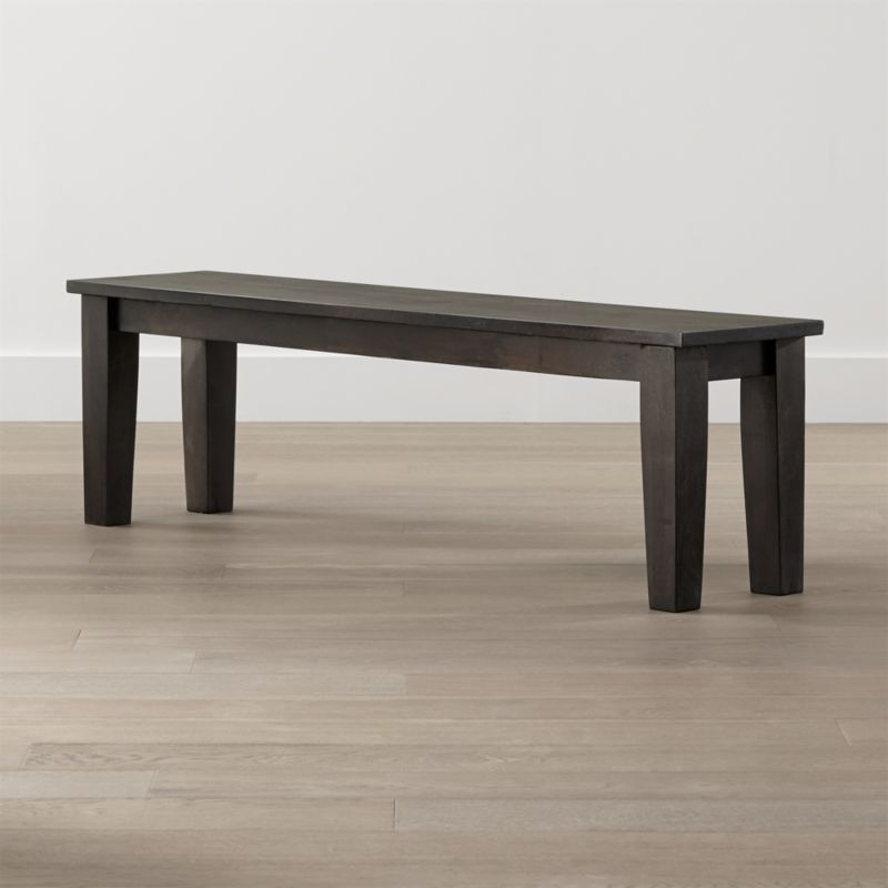 """For a more informal seating option to complement the Basque 82"""" dining table, this mid-sized bench exhibits the rustic character of a European farmhouse antique. Hand-planed planks of sustainable solid mango wood are stained a deep java brown and waxed to a soft glow that lets the wood's natural grain and knots show through. <NEWTAG/><ul><li>Sustainable solid mango wood</li><li>Java brown stain with lacquer and wax finish</li><li>Hand-planed wooden planks</li><li>Peg detailing</li><li>Naturally occurring grain and knots</li><li>Seats 3</li><li>Made in India</li></ul"""