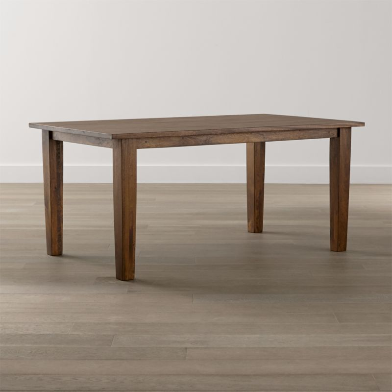 """Simple and rustic, the Basque 65"""" dining table displays the heft and character of a European farmhouse antique. With substantial legs and hand-planed wooden planks finished with authentic peg detailing, this moderately scaled 6-seat table is handcrafted of sustainable solid mango wood with a rich honey stain and lacquer finish. <NEWTAG/><ul><li>Sustainable solid mango wood</li><li>Rich honey stain with lacquer and wax finish</li><li>Hand-planed wooden planks</li><li>Peg detailing</li><li>Naturally occurring grain and knots</li><li>Seats 6</li><li>Made in India</li></ul><br />"""