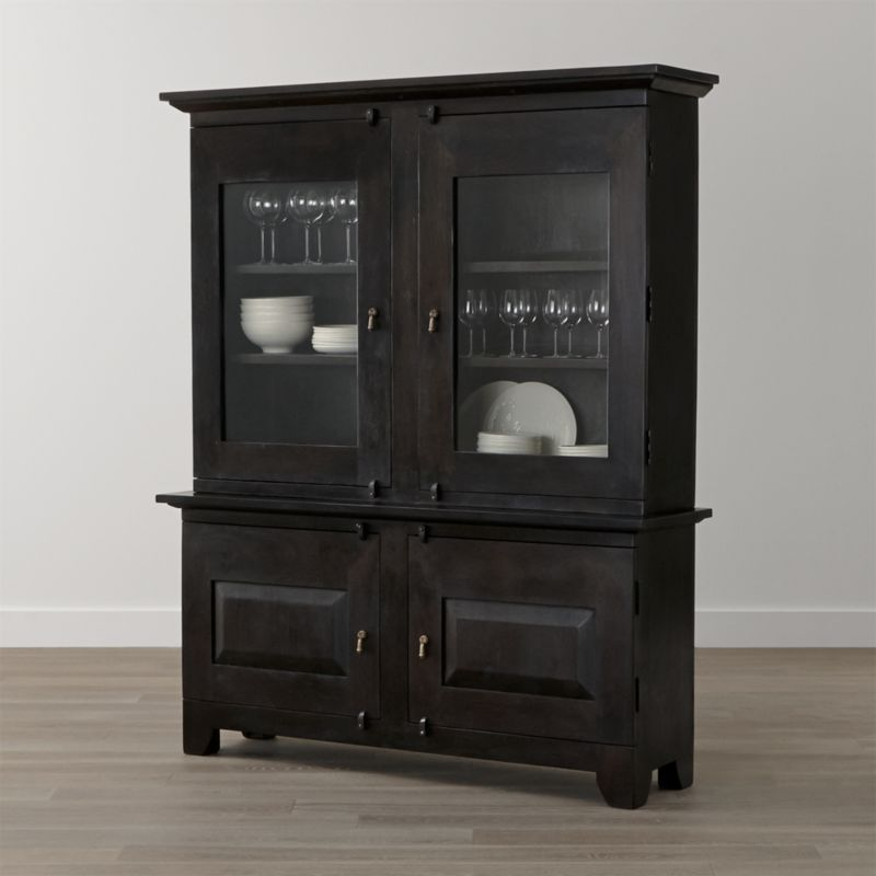 Boldly proportioned with the heft and character of European farmhouse antiques, this dining room storage duo is handmade of sustainable solid mango wood with a deep java brown finish. Featuring open and closed storage behind a combination of glass panel and wood doors, each buffet and hutch is crafted with authentic peg detailing, dangling cast brass pulls and rustic hasp closures. <NEWTAG/><ul><li>Sustainable solid mango wood</li><li>Java brown stain with lacquer and wax finish</li><li>Hand-planed wooden planks</li><li>Naturally occurring grain and knots</li><li>6 fixed shelves: 2 in buffet, 2 per side in hutch</li><li>Cast brass pulls and hasp closures</li><li>Made in India</li></ul><br />