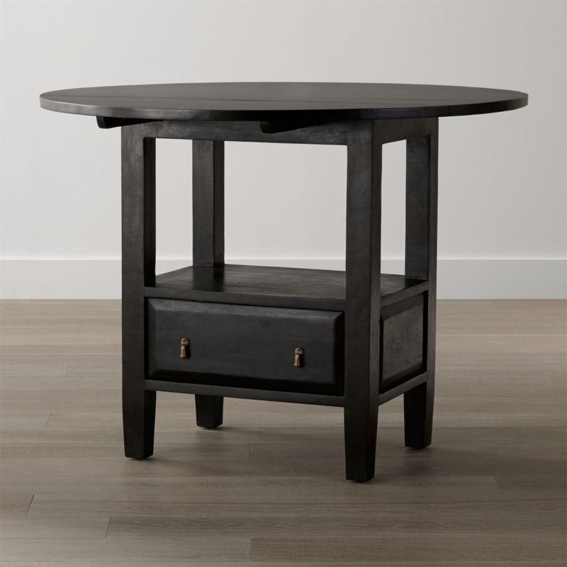 """Ideal for counter height dining in a kitchen, game room or bar, this substantial high-top dining table displays the heft and character of a European farmhouse antique. It takes its simple, rustic stance from hand-planed planks of solid sustainable mango wood, finished with authentic wooden peg detail. The deep brown java stain with lacquer finish is waxed to a soft sheen, enhancing the wood's open grain and naturally occurring knots. <NEWTAG/><ul><li>Sustainable solid mango wood</li><li>Java brown stain with lacquer finish</li><li>Hand-planed wooden planks</li><li>Peg detailing</li><li>Naturally occurring grain and knots</li><li>Drawer with cast brass drop knob pulls</li><li>Levelers</li><li>2 drop leaves</li><li>Accommodates bar stools with 24""""-high seats</li><li>Seats 4</li><li>Made in India</li></ul><br />"""
