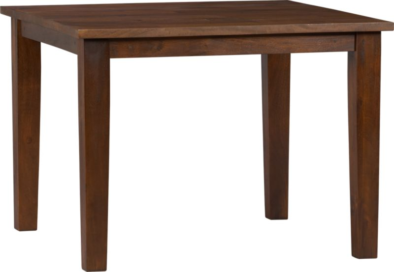 Hand-hewn, compact table has the heft and character of a European farmhouse antique. The simple, rustic design has substantial legs and a hand-planed plank top with authentic peg detailing. Open grain and knots are unique to each piece. The rich honey finish is waxed to a soft sheen.<br /><br /><NEWTAG/><ul><li>Handcrafted</li><li>Sustainable, kiln-dried solid mango wood</li><li>Naturally occurring grain and knots</li><li>Rich honey finish</li><li>Seats four</li><li>Made in India</li></ul>