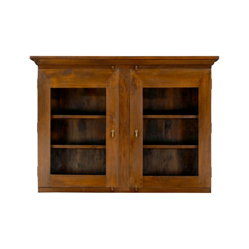 Dining room storage that recalls the heft and character of a European farmhouse antique. Simple and rustic with bold proportions, the Basque hutch is handcrafted entirely of sustainable solid mango wood with glass doors to display favorite objects. <NEWTAG/><ul><li>Sustainable solid mango wood</li><li>Rich honey stain with lacquer and wax finish</li><li>Hand-planed wooden planks</li><li>Peg detailing</li><li>Naturally occurring grain and knots</li><li>4 fixed shelves: 2 per side behind 2 glass door fronts</li><li>Cast brass pulls and hasp closures</li><li>Made in India</li></ul>