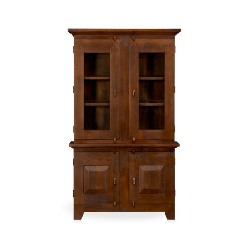Hutch top with glass doors has rustic, handcrafted detailing and antique appeal scaled for smaller spaces. The rich honey finish is waxed to a soft sheen.<br /><br /><NEWTAG/><ul><li>Handcrafted</li><li>Sustainable, kiln-dried solid mango wood</li><li>Peg detailing</li><li>Naturally occurring grain and knots</li><li>Rich honey finish</li><li>Four fixed shelves: two per side</li><li>Dangling, cast brass pulls and rustic hasp closures</li><li>Made in India</li></ul>