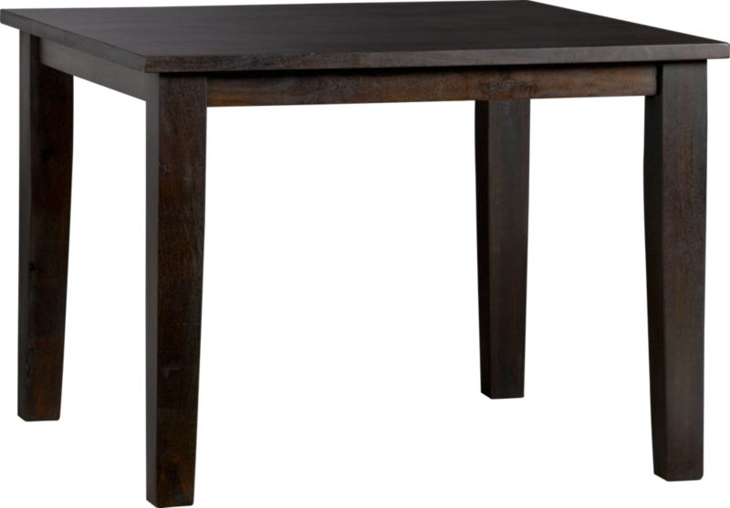 Hand-hewn, compact table has the heft and character of a European farmhouse antique. The simple, rustic design has substantial legs and a hand-planed plank top with authentic peg detailing. Open grain and knots are unique to each piece. The deep java finish is waxed to a soft sheen.<br /><br /><NEWTAG/><ul><li>Handcrafted</li><li>Sustainable, kiln-dried solid mango wood</li><li>Naturally occurring grain and knots</li><li>Deep java finish</li><li>Seats four</li><li>Made in India</li></ul>