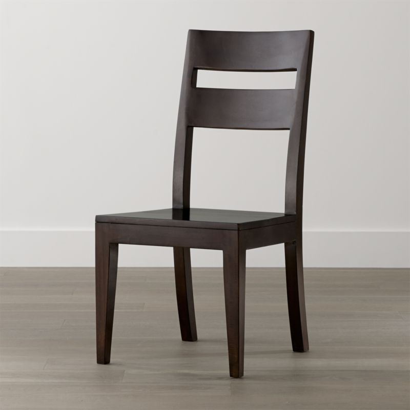 Our Basque collection offers versatile seating options to pair with the various dining tables, including benches, bar stools and this classic side chair. Handcrafted of sustainable solid mango wood with a deep java brown finish, the Basque chair has a strong yet comfortable presence with generous proportions, a tall, modified double-slat back and deep seat. Basque recalls the simple, rustic character of European farmhouse antiques. <NEWTAG/><ul><li>Sustainable solid mango wood</li><li>Java brown stain with lacquer finish</li><li>Hand-planed wooden planks</li><li>Peg detailing</li><li>Made in Indonesia</li></ul>