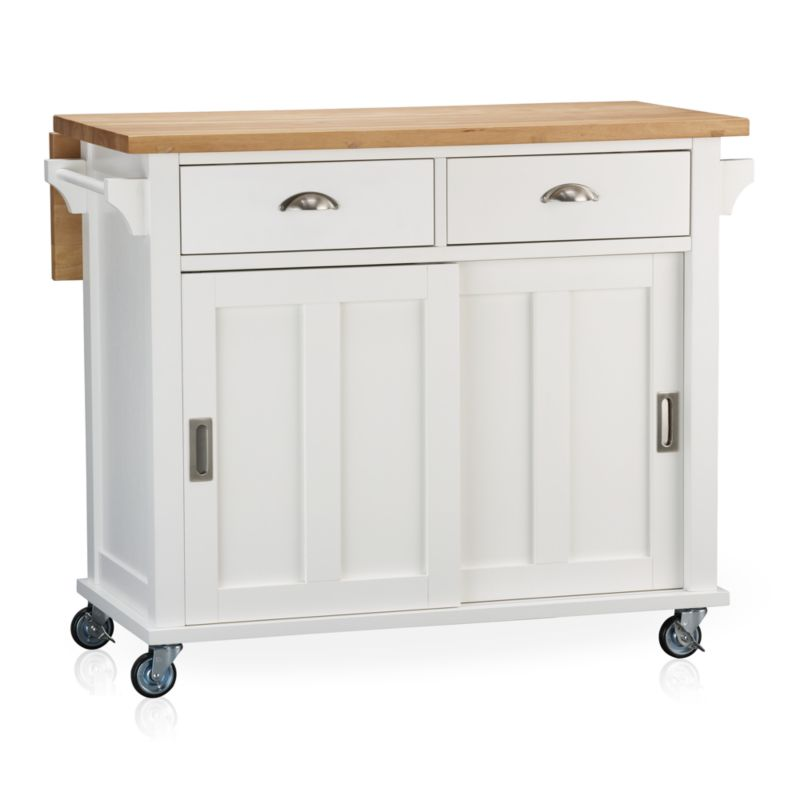 """Instantly expand your kitchen's work surface and storage area with a contemporary cottage-inspired island. Beautifully grained plank top is crafted from sustainable solid rubberwood with an oil finish. Solid wood veneered base with a white lacquer finish rests on four industrial-grade casters, making it easy to move or store. Also includes the option of four sturdy tapered feet (see additional photographs). Two deep drawers, sliding door recessed panel cabinet with one adjustable shelf, and two towel bars provide generous storage.<br /><br /><NEWTAG/><ul><li>Sustainable solid rubberwood top with foodsafe oil finish</li><li>Base is low-emission engineered wood with rubberwood veneer and lacquer finish</li><li>Brushed nickel hardware</li><li>Casters and optional wood feet</li><li>Accommodates counter stools with 24""""H seats</li><li>Made in Thailand</li></ul>"""