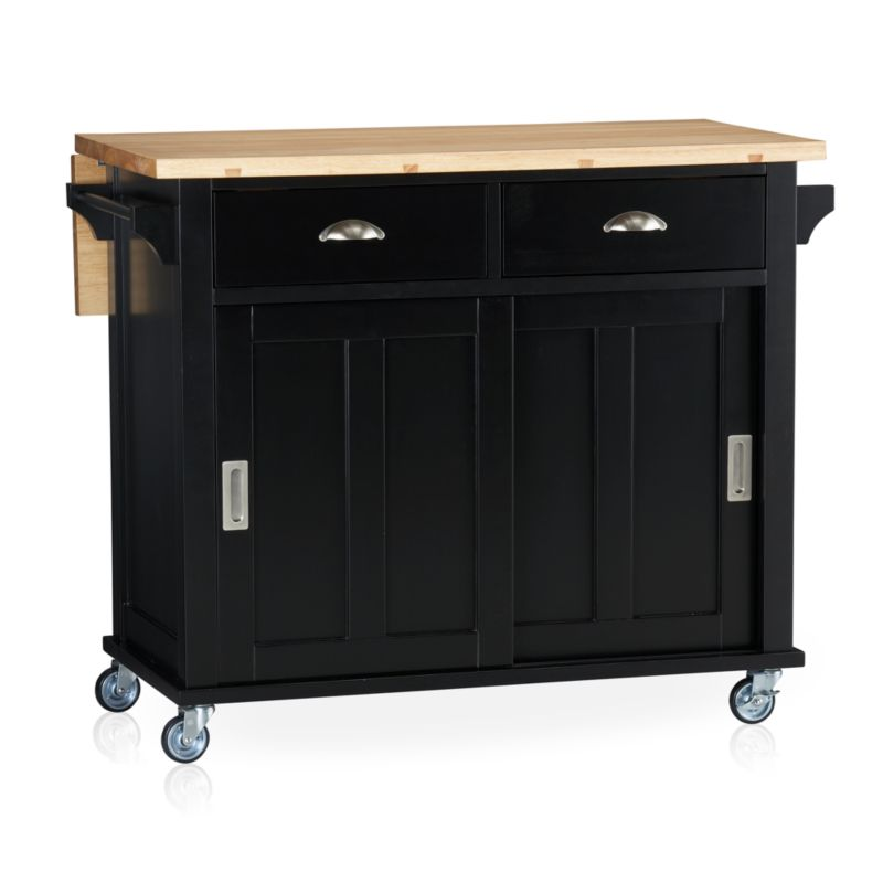 "Instantly expand your kitchen's work surface and storage area with a contemporary cottage-inspired island. Beautifully grained plank top is crafted from sustainable solid rubberwood with an oil finish. Solid wood veneered base with a black lacquer finish rests on four industrial-grade casters, making it easy to move or store. Also includes the option of four sturdy tapered feet (see additional photographs). Two deep drawers, sliding door recessed panel cabinet with one adjustable shelf, and two towel bars provide generous storage.<br /><br /><NEWTAG/><ul><li>Sustainable solid rubberwood top with foodsafe oil finish</li><li>Base is low-emission engineered wood with rubberwood veneer and lacquer finish</li><li>Brushed nickel hardware</li><li>Casters and optional wood feet</li><li>Accommodates counter stools with 24""H seats</li><li>Made in Thailand</li></ul>"