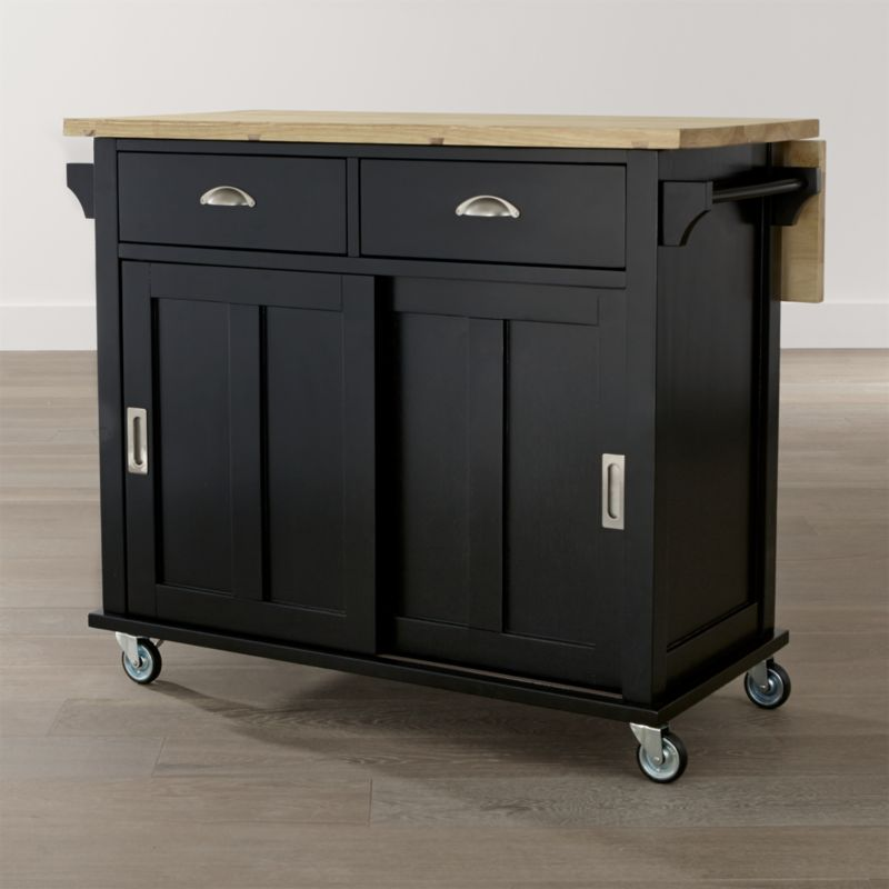 Instantly expand your kitchen's work surface and storage area with Belmont, our contemporary kitchen island with a retro heritage. The sustainable solid rubberwood top features a foodsafe oil finish and a drop leaf, supported by a base with hidden drawers and shelving. <NEWTAG/><ul><li>Designed by Bill Eastburn of William Eastburn Design</li><li>Sustainable solid rubberwood top with foodsafe oil finish</li><li>Engineered wood with rubberwood veneer</li><li>Base painted black with clear lacquer finish</li><li>Brushed nickel hardware</li><li>Accommodates counter stools with leaf up</li><li>Casters (2 locking) and optional wood feet</li><li>Made in Thailand</li></ul><br />