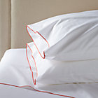 Belo Coral King Sheet Set. Includes one flat sheet, one fitted sheet and two standard pillowcases.