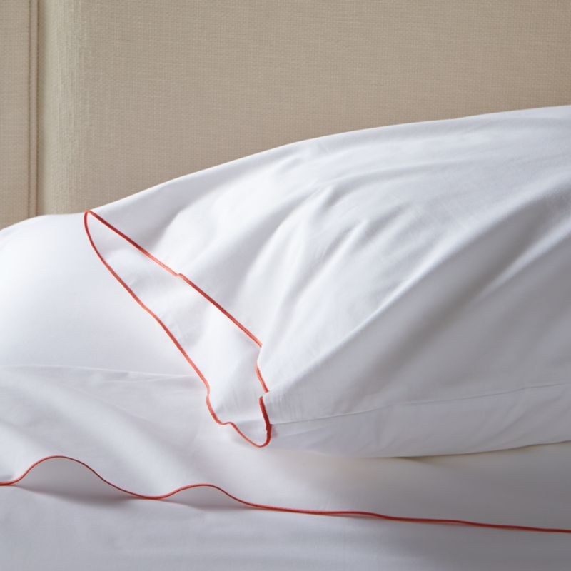Clean, basic white bedding upgrades in soft, smooth cotton percale, beautifully contrasted with a graceful coral overlocking stitch on the flat sheet and pillowcase. Generous fitted sheet pockets accommodate thicker mattresses. Set includes one flat sheet, one fitted sheet and one standard pillowcase. Bed pillows also available.<br /><br /><NEWTAG/><ul><li>100% cotton percale</li><li>200-thread-count</li><li>Machine wash; tumble dry low</li><li>Made in Portugal</li></ul><br />
