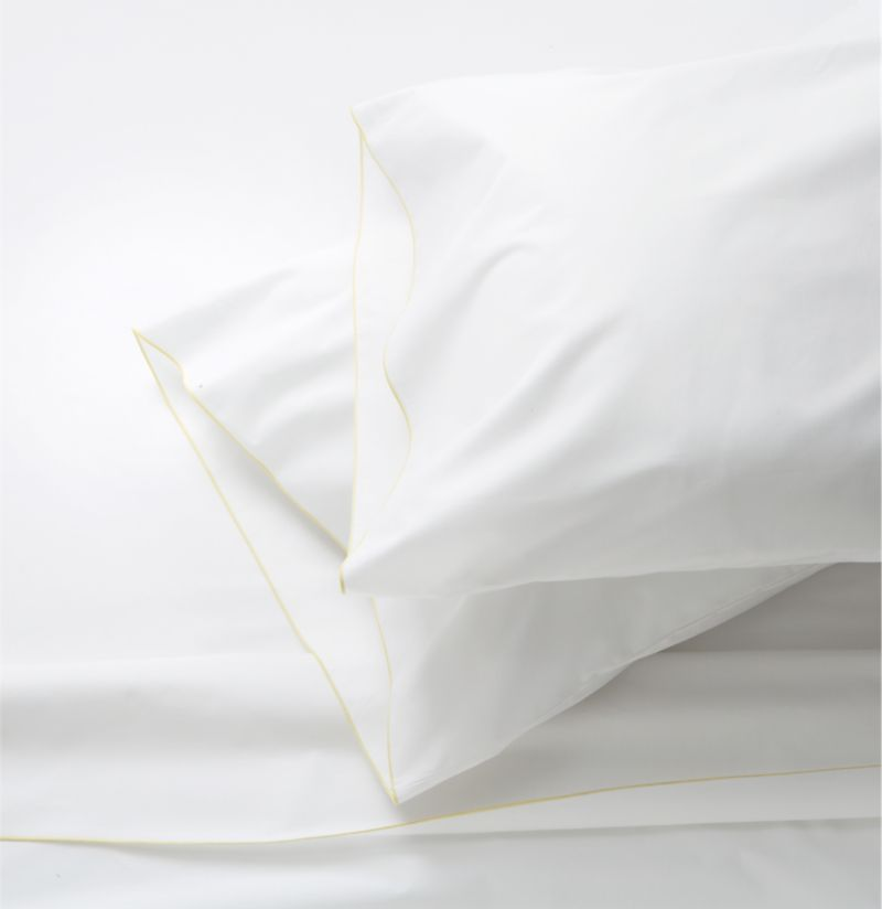 Clean, basic white bedding upgrades in soft, smooth cotton percale, beautifully contrasted with a graceful yellow overlocking stitch on the flat sheet and pillowcase. Generous fitted sheet pockets accommodate thicker mattresses. Sheet set includes one flat sheet, one fitted sheet and two standard pillowcases. Bed pillows also available.<br /><br /><NEWTAG/><ul><li>100% cotton percale</li><li>200-thread-count</li><li>Machine wash; tumble dry low</li><li>Made in Portugal</li></ul>