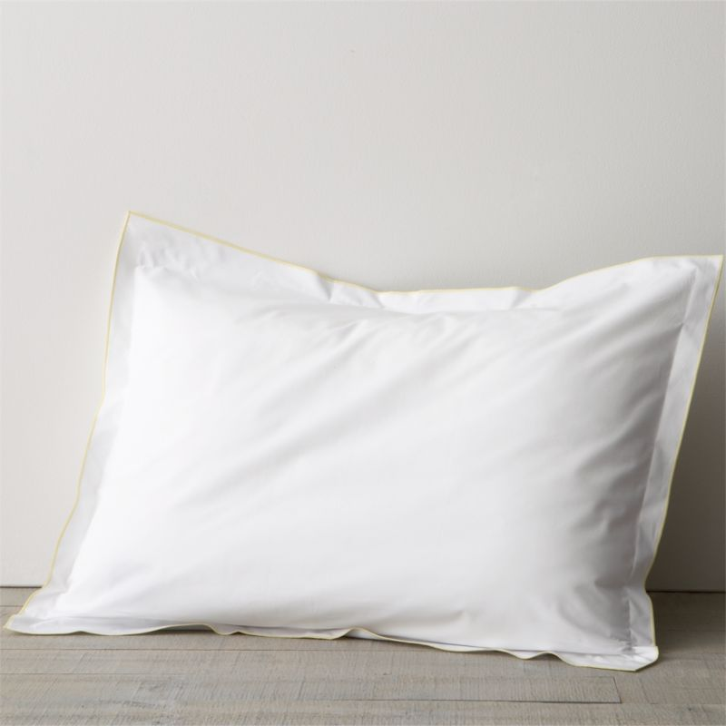 "Clean, basic white bedding upgrade in soft, smooth cotton percale, beautifully contrasted with a graceful yellow overlocking stitch. Pillow sham has 1""  flange and generous overlapping closure.<br /><br /><NEWTAG/><ul><li>100% cotton percale</li><li>200-thread-count</li><li>Machine wash; tumble dry low</li><li>Made in Portugal</li></ul>"