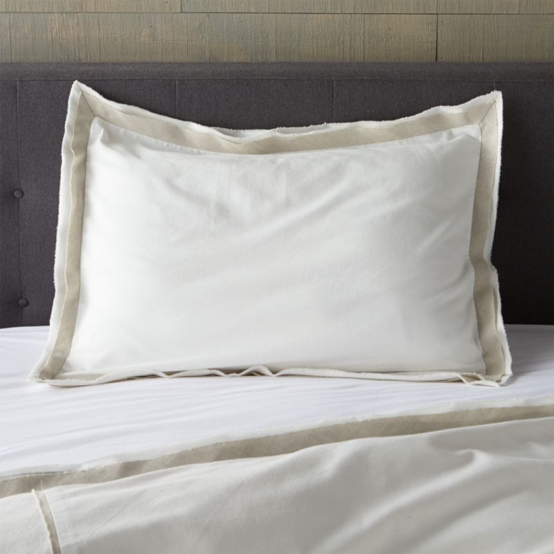 Linen and cotton seam up as neutral naturals with a modern edge. White shams are framed in a natural flange with frayed for a casual, artisanal feel. Bed pillows also available.<br /><br /><NEWTAG/><ul><li>Base fabric is 88% Cotton and 12% Linen</li><li>Decorative fabric is 52% linen and 48% cotton</li><li>Envelope closure</li><li>Machine wash cold, tumble dry low</li><li>Made in India</li></ul>