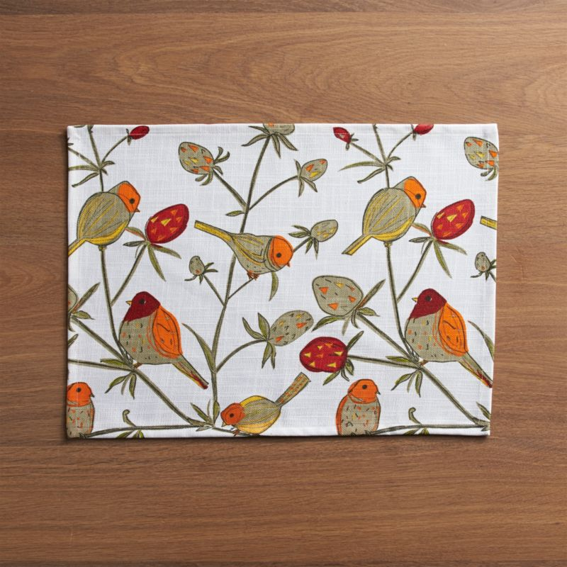 Sketched design places plump birds on fanciful, fruited branches in this springy cotton placemat, coated with food-safe acrylic for speedy clean ups.<br /><br /><NEWTAG/><ul><li>100% cotton with acrylic coating</li><li>Clean with a damp cloth</li><li>Made in India</li></ul>