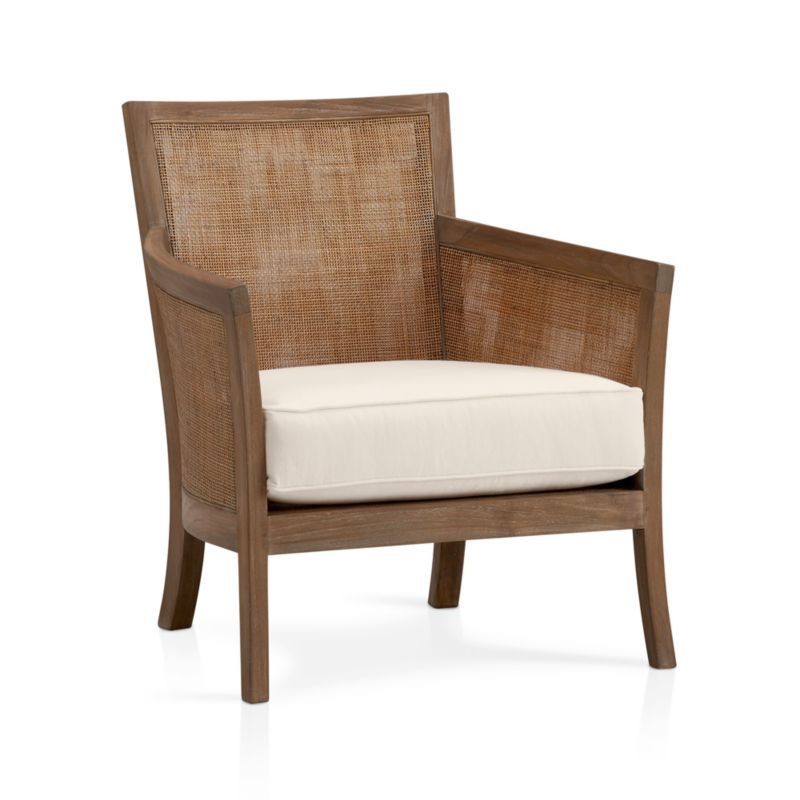 "We've freshened up our popular solid teak and handwoven rattan lounge seating with a soft grey wash and white cotton-poly cushions. And, more importantly, we've given it an eco-friendly upgrade: The frame is crafted of plantation-grown teak supported by TFT, a nonprofit organization that promotes responsible forest management, and the 5""-thick cushioning is multilayer soy- or plant-based polyfoam. Strong webbed suspension supports the woven rattan seat. A great chair in pairs. Also stocked in espresso finish with leather cushion.<br /><br /><NEWTAG/><ul><li>Solid teak harvested from plantations working with TFT and woven rattan mesh</li><li>Grey wash finish</li><li>Nylon webbing suspension</li><li>Cotton-polyester cushion with multilayer soy- or plant-based polyfoam</li><li>Professional cushion cleaning recommended</li><li>Made in Indonesia and USA </li></ul>"