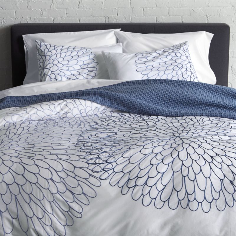 Full-blossom blooms in tonal blues embroider large clusters of graphic petals on crisp white cotton for a fresh bedding pattern that's perfect for spring. Linens reverse to solid white. Duvet has hidden button closure and interior fabric ties to keep insert in place. Duvet insert also available.<br /><br /><NEWTAG/><ul><li>100% cotton percale</li><li>180-thread-count</li><li>100% rayon embroidery</li><li>Hidden button closure and interior fabric ties</li><li>Machine wash cold, tumble dry low; warm iron as needed</li><li>Made in India</li></ul><br />
