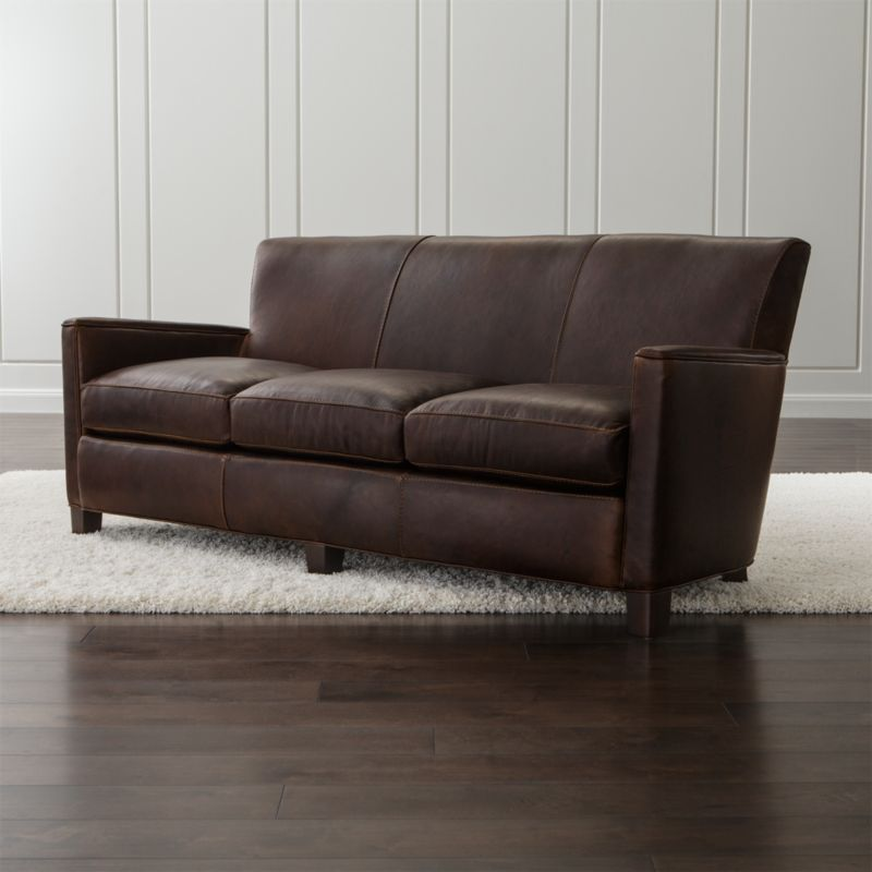 Architectural lines meet rich vintage-inspired leather in this distinctive nod to Art Deco. Leather club chair comfort is top-of-the-line with an eight-way, hand-tied suspension system and 3 seat cushions that provide a luxurious sink-in experience for 3. <NEWTAG/><ul><li>Frame is benchmade in the USA with certified sustainable hardwood that's kiln dried to prevent warping</li><li>Soy-based polyfoam with fiber back cushion encased in synthetic ticking</li><li>Eight-way, hand-tied suspension</li><li>Hardwood legs with black walnut stain</li><li>Material origin: see swatch</li><li>Made in North Carolina, USA</li></ul><br />