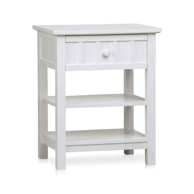 Brighton modernizes classic cottage styling with this casual nightstand. Crafted of solid poplar and engineered wood with a fresh white lacquer finish, the Brighton nightstand offers bedside convenience with 1 drawer positioned above 2 open display shelves. <NEWTAG/><ul><li>Designed by Blake Tovin of Tovin Design</li><li>Solid poplar and engineered wood white lacquer finish</li><li>Naturally expands and contracts with changes in humidity</li><li>1 drawer</li><li>2 open display shelves</li><li>Metal side-mounted glides</li><li>White porcelain knob</li><li>Made in Vietnam</li></ul>