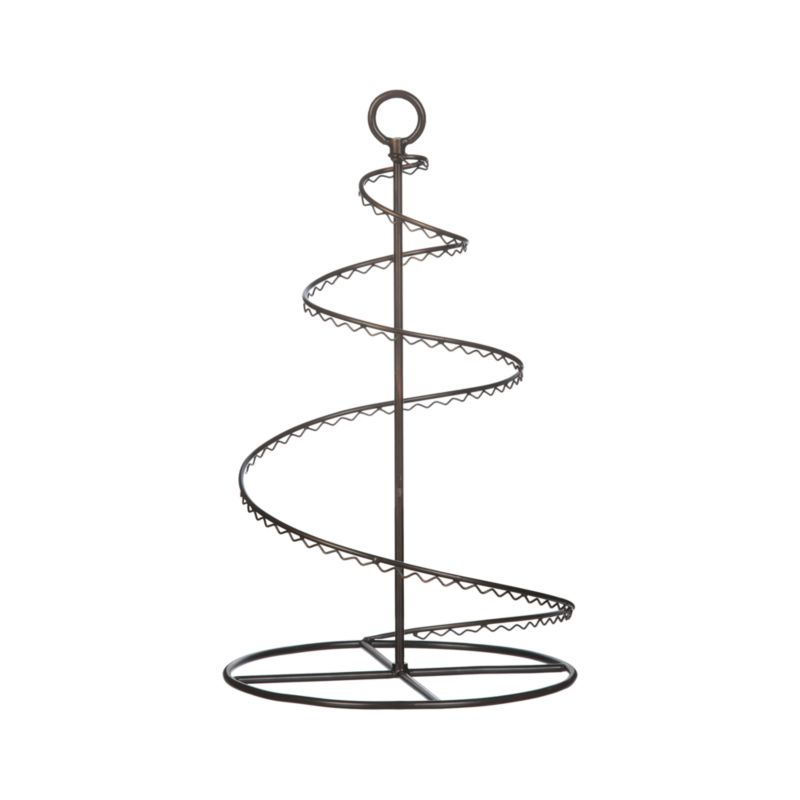 A graceful 20-inch spiral of bronzed wire with scalloped trim is handcrafted to display a dozen of your favorite ornaments. Pieces separate to fold flat for out-of-season storage.<br /><br /><NEWTAG/><ul><li>100% iron</li><li>Antiqued bronze finish</li><li>24 hooks included</li><li>Clean with a damp cloth</li><li>Made in India</li></ul>